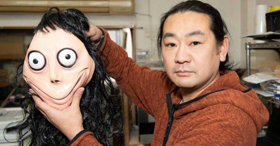 Artist Keisuke Aiso with Momo mask